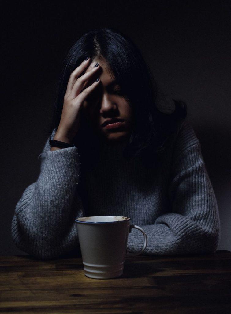 Worry-woman with mug