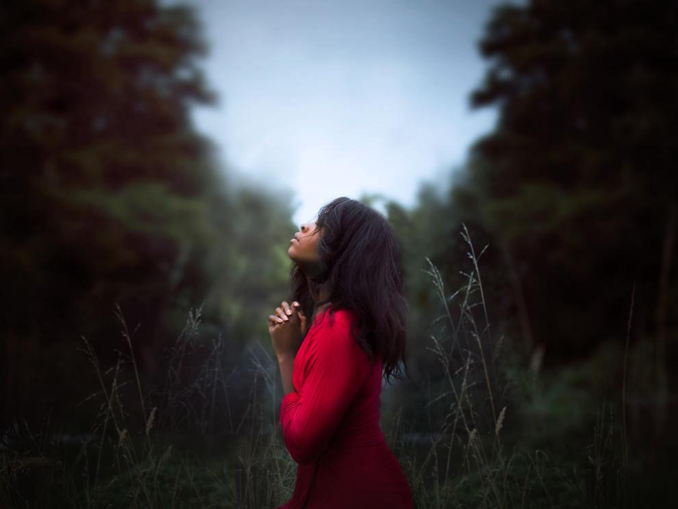 black woman praying profile
