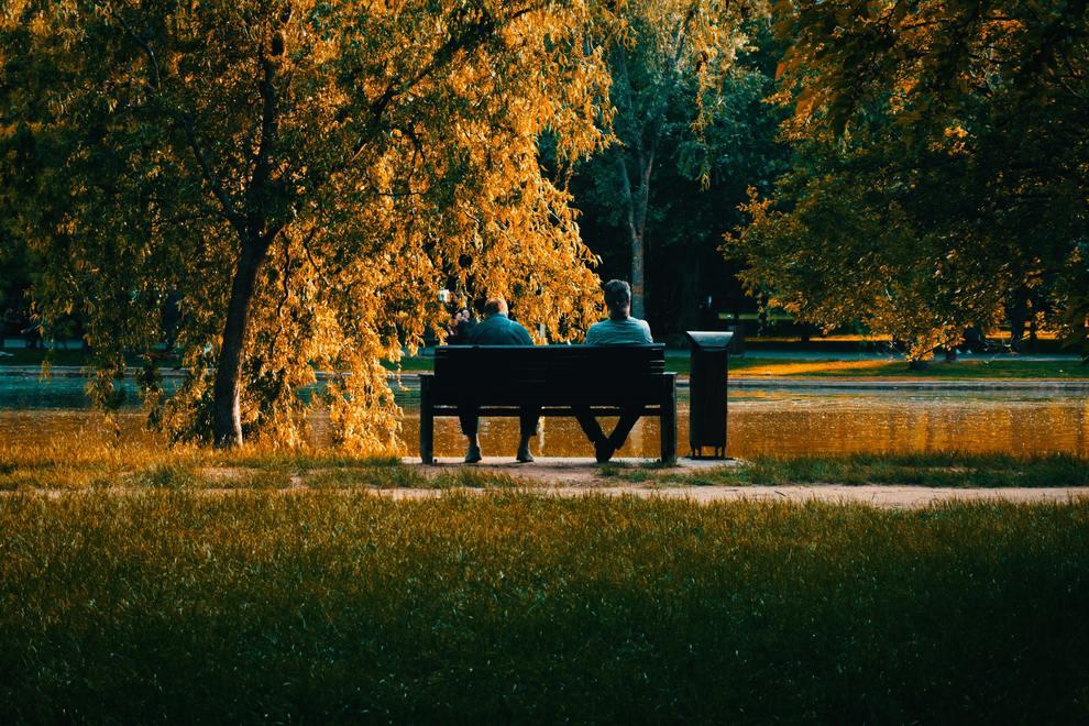 men on park bench