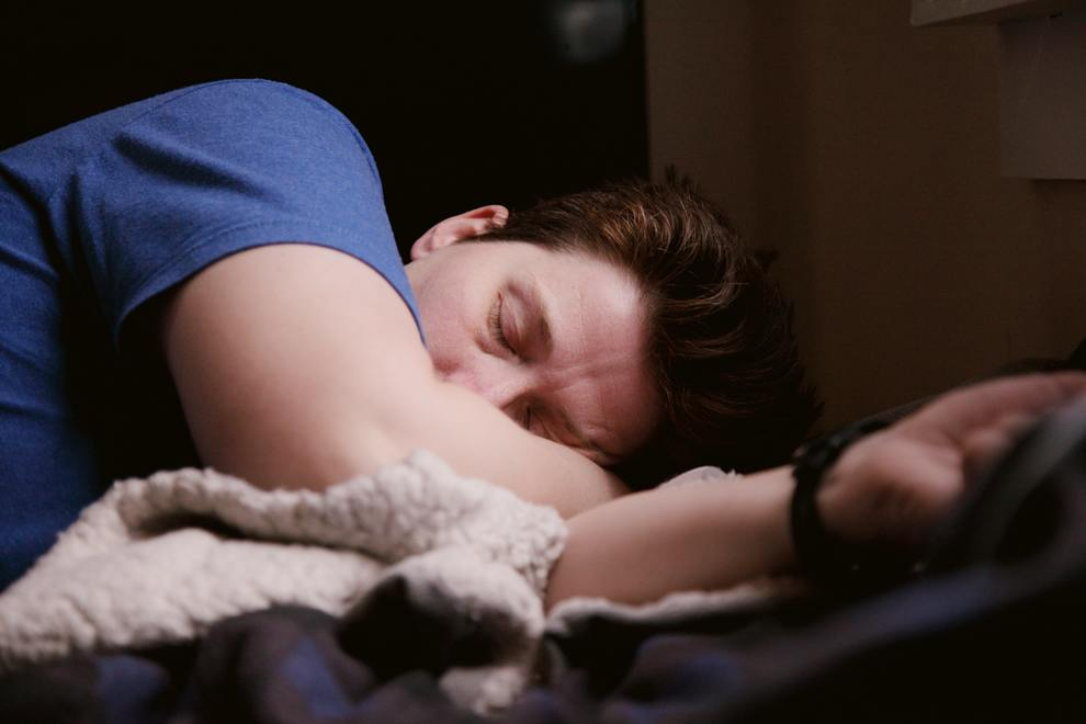 young man lethargy bed